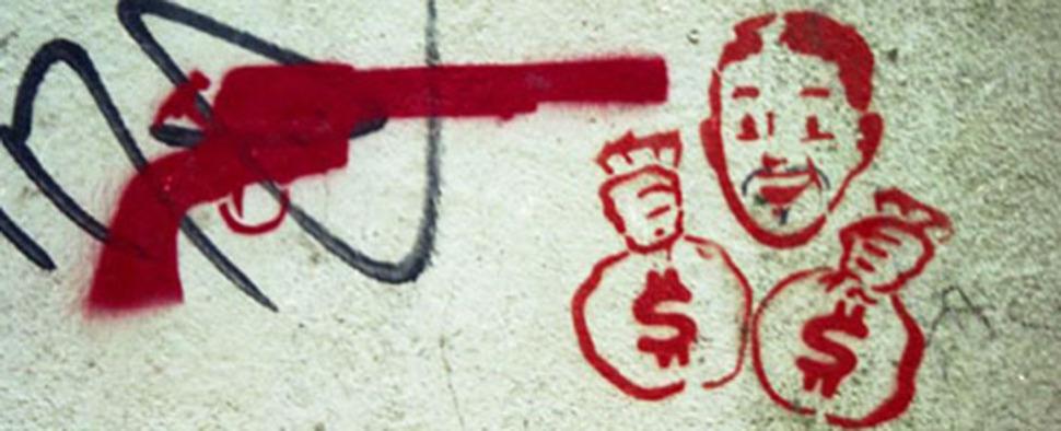 Rotes Graffiti auf einer Steinwand